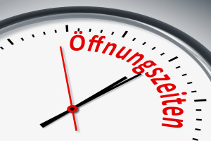 Eine Uhr mit Text Zeit Oeffnungszeiten